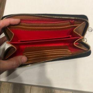 Dooney & Bourke Bags - Dooney and Bourke all leather wallet